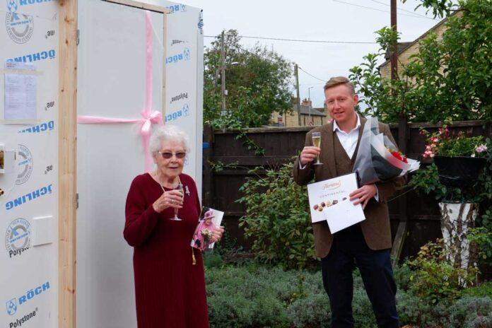 Cambridgeshire centenarian Mona Garbutt celebrating her birthday with Taplanes Specification Engineer Dan Wilkinson inside cambs